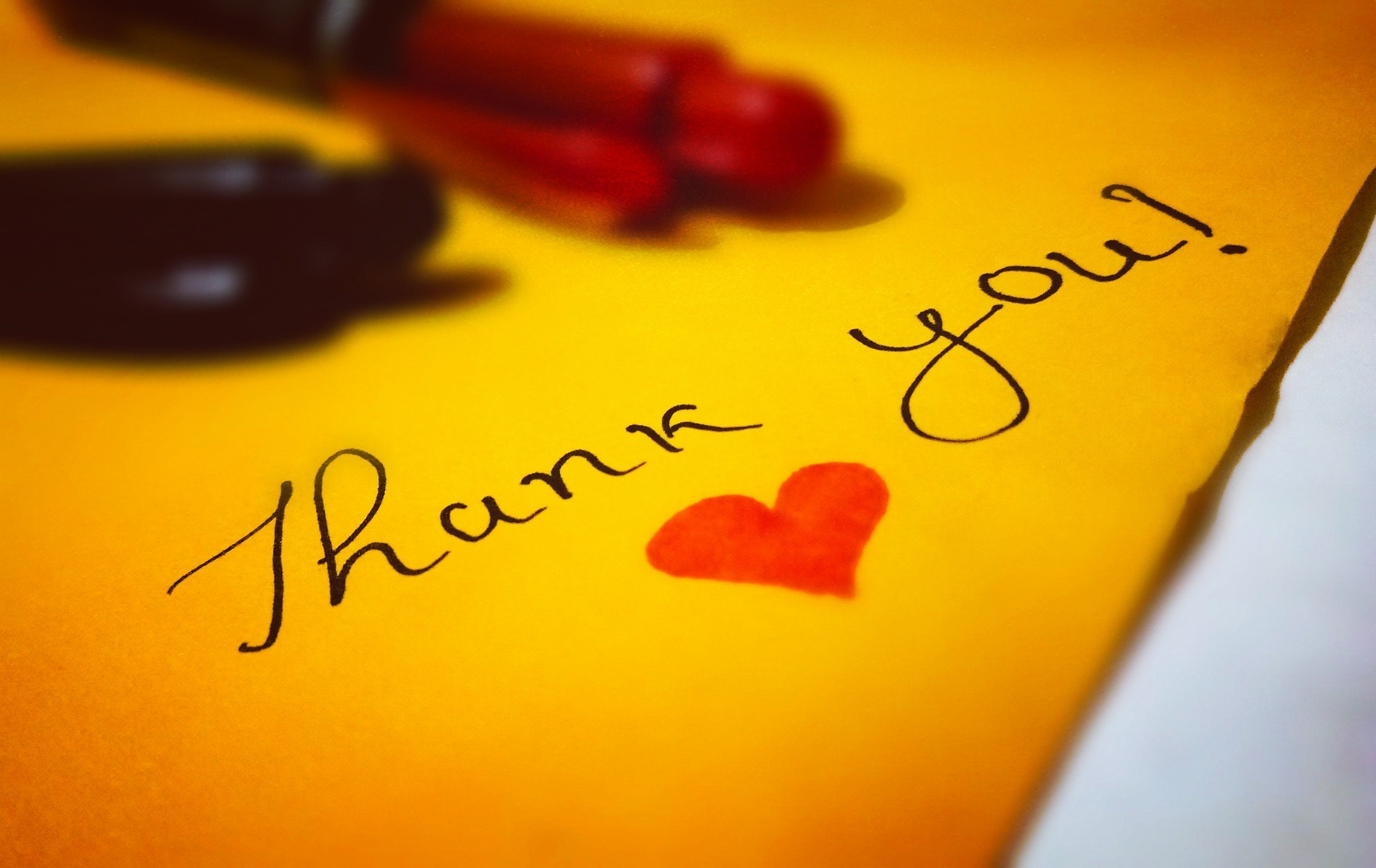 Yellow letter with thank you written on it